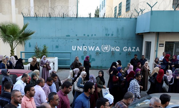 FILE PHOTO: Palestinian employees of United Nations Relief and Works Agency (UNRWA) take part in a protest against job cuts by UNRWA, in Gaza City September 19, 2018. REUTERS/Ibraheem Abu Mustafa//File Photo