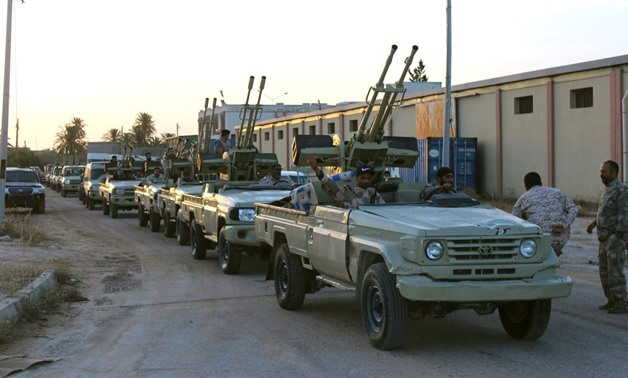 Military vehicles of members of the Libyan internationally recognised government forces head out from Misrata to the front line in Tripoli, Misrata, Libya May 10, 2019. REUTERS/Ayman Al-Sahili