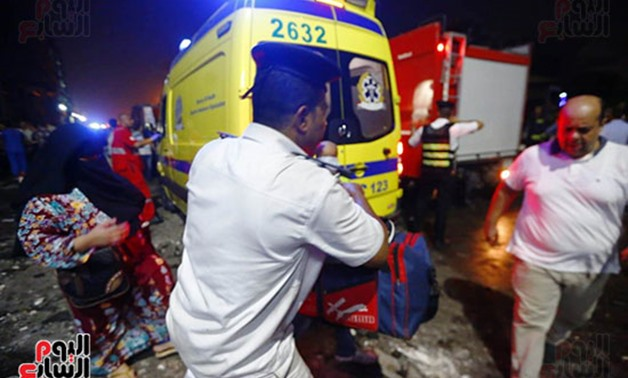 Ambulance vehicle transfering patients to hospitals to receive treatment after deadly car crash hit Central Cairo Sunday - Egypt Today