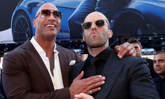 "FILE PHOTO: Cast members Dwayne Johnson and Jason Statham arrive at the premiere for ""Fast & Furious Presents: Hobbs & Shaw"" in Los Angeles, California, U.S., July 13, 2019. REUTERS/Mario Anzuoni/File Photo
