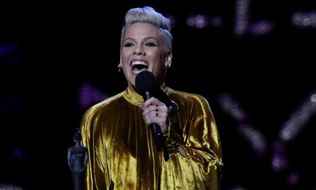 FILE PHOTO: Pink with the award for Outstanding Contribution at the Brit Awards at the O2 Arena in London, Britain, February 20, 2019. REUTERS/Hannah McKay/File Photo