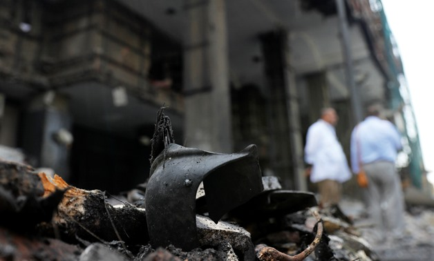 Belongings of victims are seen amid rubble in front of the damaged facade of the National Cancer Institute after an overnight fire from a blast, in Cairo, Egypt August 5, 2019. REUTERS/Amr Abdallah Dalsh
