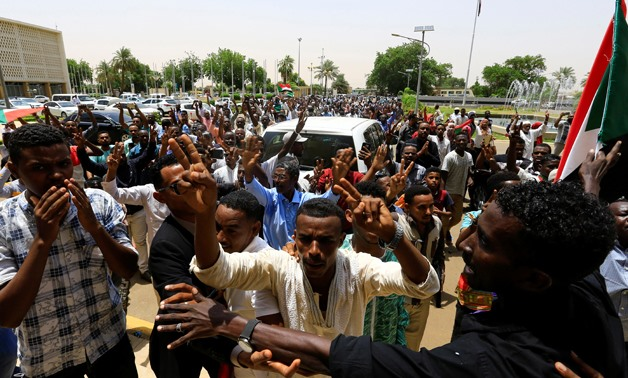 Sudanese people carry their national flag and chant slogans as they celebrate the signing of a constitutional declaration between Deputy Head of Sudanese Transitional Military Council, Mohamed Hamdan Dagalo and Sudan's opposition alliance coalition's lead