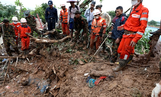 Rescue workers search for bodies under debris and mud after a landslide in Mottama, Mon state, Myanmar, August 10, 2019. REUTERS/Ann Wang