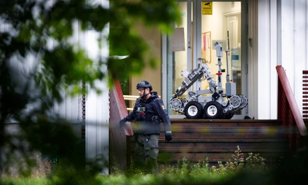 A man is seen near the site after a shooting in al-Noor Islamic center mosque, near Oslo, Norway August 10, 2019. NTB Scanpix/Terje Pedersen via REUTERS ATTENTION EDITORS - THIS IMAGE WAS PROVIDED BY A THIRD PARTY. NORWAY OUT. NO COMMERCIAL OR EDITORIAL S