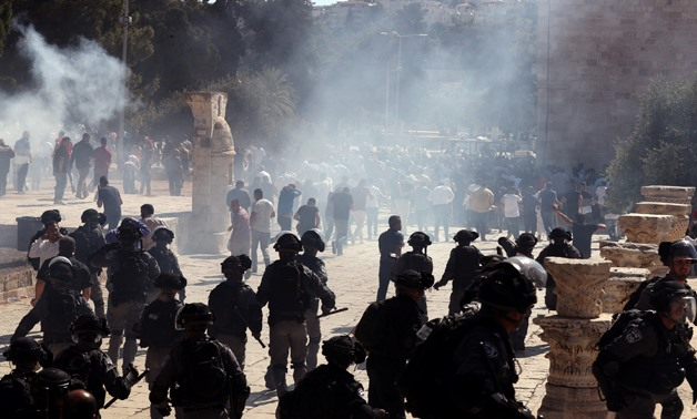 Smoke is seen after sound grenades exploded as Israeli police clash with Palestinian worshippers on the compound known to Muslims as Noble Sanctuary and to Jews as Temple Mount as Muslims mark Eid al-Adha in Jerusalem's Old City August 11, 2019. REUTERS/A