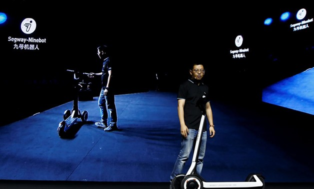 Ninebot President Wang Ye unveils semi-autonomous scooter KickScooter T60 that can return itself to charging stations without a driver, at a Segway-Ninebot product launch event in Beijing, China August 16, 2019. REUTERS/Florence Lo