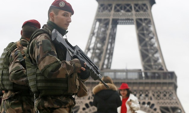 "French soldier patrol near the Eiffel Tower in Paris as part of the highest level of ""Vigipirate"" security plan after a shooting at the Paris offices of Charlie Hebdo January 9, 2015. REUTERS/Gonzalo Fuentes"