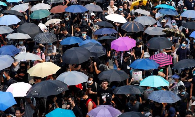 People march during a protest in Hong Kong, China, August 24, 2019. REUTERS/Kai Pfaffenbach