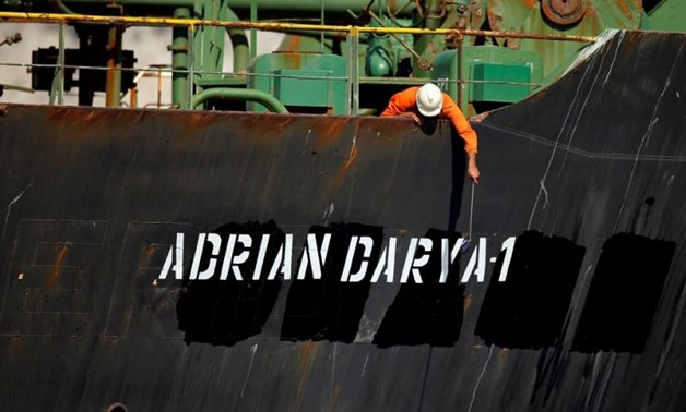 A crew member takes pictures with a mobile phone on Iranian oil tanker Adrian Darya 1, previously named Grace 1, sits anchored after the Supreme Court of the British territory lifted its detention order, in the Strait of Gibraltar, Spain, August. (Reuters