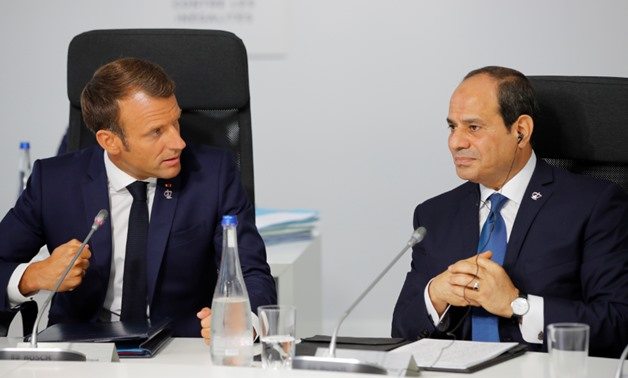 Egyptian President Abdel Fattah al-Sisi (R) meets with France's President Emmanual Macron on the sidelines of the G7 summit in Biarritz – SAA/Reuters