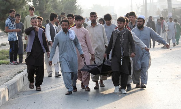 Afghan men carry the dead body of a civilian at the site of a blast in Kabul, Afghanistan, September 3, 2019 - Reuters