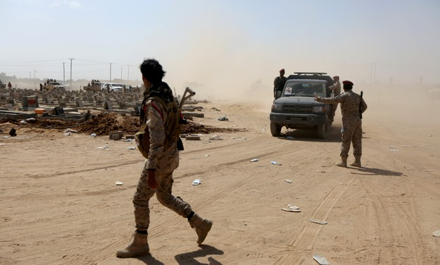 FILE PHOTO: Yemeni army soldiers secure the site of a funeral for a Yemeni army officer killed in the southern province of Abyan in clashes with UAE-backed southern separatist forces, in Marib, Yemen, August 31, 2019. REUTERS/Ali Owidha/File Photo
