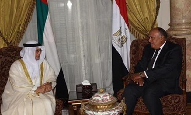 Foreign Minister Sameh Shoukry (R) and UAE Minister of State for Foreign Affairs Anwar Qarqash (L) - Photo via SIS