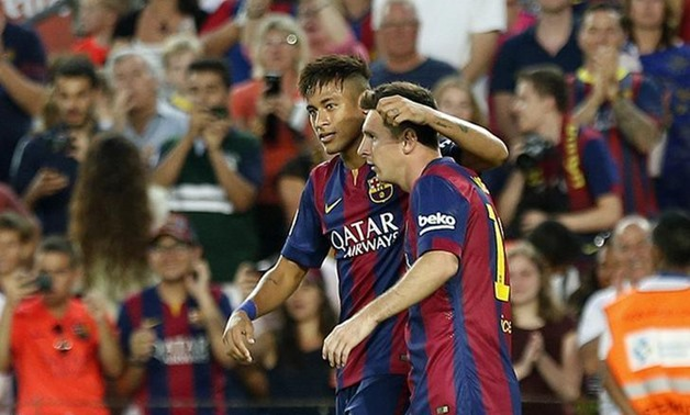 Caption: Barcelona's Lionel Messi (R) celebrates his goal with teammate Neymar against Mexican club Leon during their Joan Gamper Trophy match at Nou Camp stadium in Barcelona August 18, 2014. REUTERS/Gustau Nacarino
