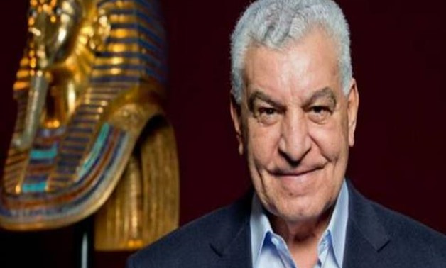 FILE - Hawass and Tutankhamun mask