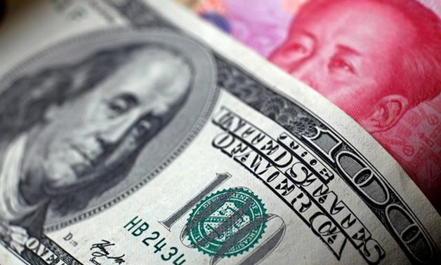 FILE PHOTO: U.S. dollar and China yuan notes are seen in this picture illustration June 2, 2017. REUTERS/Thomas White