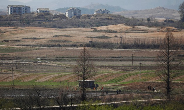North Korean people work on a rice field at the propaganda village of Gijungdong in North Korea in this April 11, 2018 picture. (Reuters)