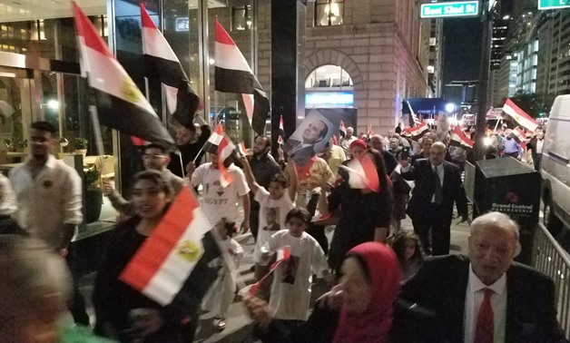 Dozens of Egyptian community members in NYC gathered in the streets, carrying Egyptian flags to welcome President Sisi - Egypt Today