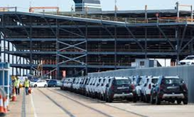 FILE PHOTO: Cars readied for export are parked next to a vehicle storage facility on the dockside at the ABP port in Southampton, Britain August 16, 2017. REUTERS/Peter Nicholls