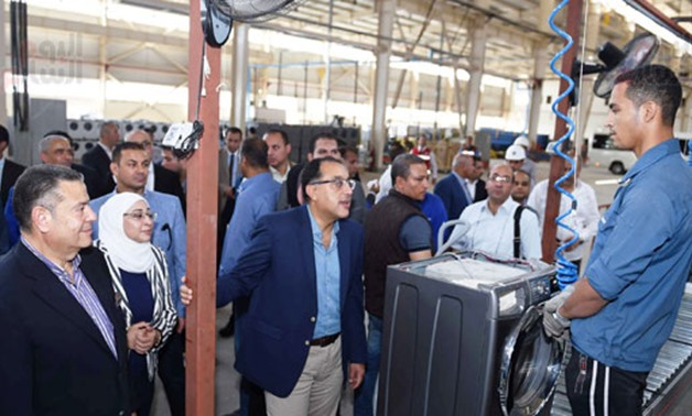 Prime Minister Mustafa Madbouli during his visit to El Araby Group factories complex in the industrial zone in the Upper Egyptian governorate of Beni Suef - Press Photo