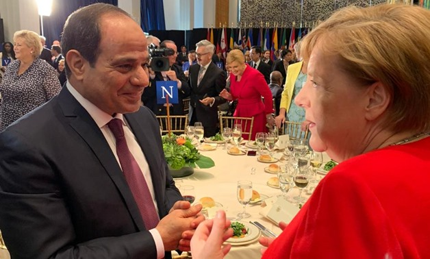 Egyptian President Abdel Fatah al Sisi talks with the German Chancellor Angela Merkel during the dinner banquet on the sidelines of the UNGA: press photo