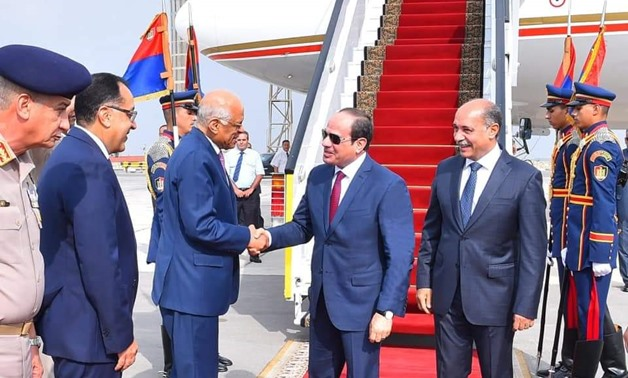 Parliament Speaker Ali Abdel Aal and key ministers receive Sisi at Cairo airport- press photo