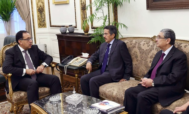 Prime Minister Mostafa Madbouly (L) in a meeting with Chairman of Acwa Power Mohamed Abdullah Abou Neyan and Minister of Electricity and Renewable Energy Mohamed Shaker (R) in the cabinet's headquarters in Cairo, Egypt. September 27, 2019. Press Photo