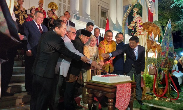 Indonesian Ambassador to Egypt Helmy Fawzy, his spouse, Egyptian guests of honor are cutting cake to celebrate the Indonesian Independence day in Cairo- Samar Samir/ Egypt Today
