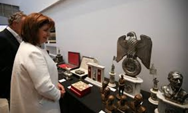 Argentine Security Minister Patricia Bullrich looks at Nazi artefacts before a news conference at the Holocaust museum in Buenos Aires, Argentina October 2, 2019. REUTERS/Agustin Marcarian