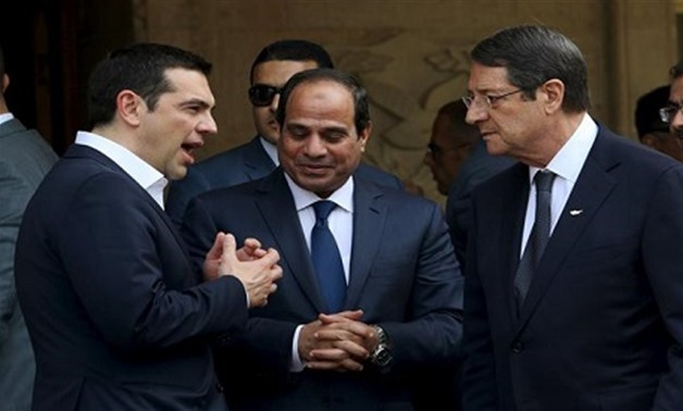 A file photo of Egyptian President Abdel Fattah al-Sisi (C), Cypriot President Nicos Anastasiades (R) and Greek Prime Minister Alexis Tsipras chatting outside the Presidential Palace in Nicosia, April 29, 2015. (Reuters)