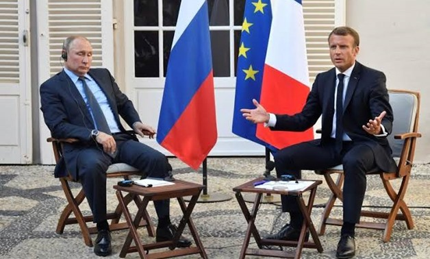 FILE PHOTO: French President Emmanuel Macron meets Russia's President Vladimir Putin, at his summer retreat of the Bregancon fortress on the Mediterranean coast, near the village of Bormes-les-Mimosas, southern France, on August 19, 2019. Gerard Julien/Po