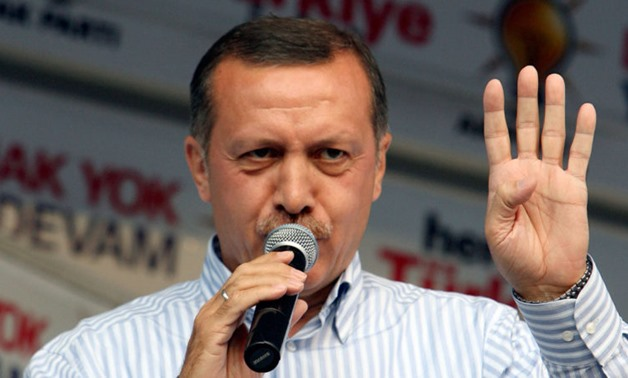 Turkey's President Erdogan from the Islamist AK Party makes the Rabia sign of the Muslim Brotherhood (Photo: Reuters)