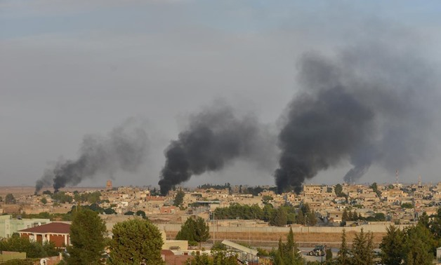Smoke rises from the Syrian border town of Ras al-Ain as it is pictured from the Turkish town of Ceylanpinar in Sanliurfa province, Turkey, October 9, 2019. REUTERS/Stringer