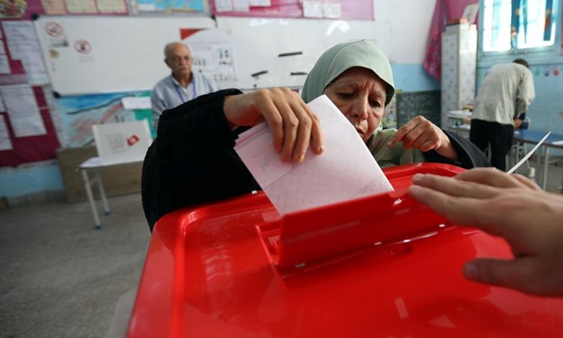 A woman casts her vote in a polling station during presidential election in Tunis, Tunisia, September 15, 2019. REUTERS/Muhammad Hamed