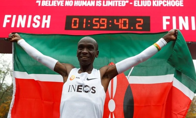 Kenya's Eliud Kipchoge, the marathon world record holder, celebrates after a successful attempt to run a marathon in under two hours in Vienna, Austria, October 12, 2019. REUTERS/Leonhard Foeger