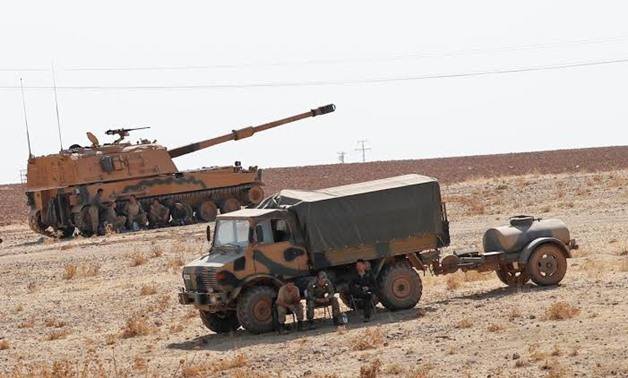 FILE PHOTO: Turkish army vehicles and military personnel are stationed near the Turkish-Syrian border in Sanliurfa province, Turkey, October 12, 2019. REUTERS/Murad Sezer