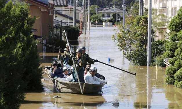 Local residents are rescued by Japapnese Defence-Force soldiers from a flooded area caused by Typhoon Hagibis in Kakuda, Miyagi prefecture, Japan, October 13, 2019, in this photo taken by Kyodo. Mandatory credit Kyodo/via REUTERS