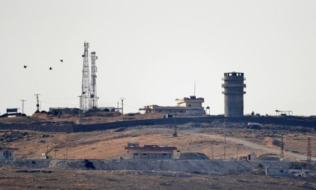 An abandoned U.S. observation post is seen from the Turkish border town of Suruc, in Sanliurfa province, Turkey, October 14, 2019. REUTERS/Murad Sezer