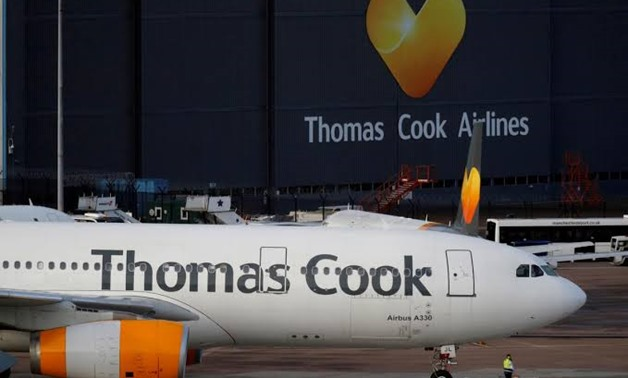 FILE PHOTO: A grounded airplane with the Thomas Cook livery is seen at Manchester Airport, Manchester, Britain September 23, 2019. REUTERS/Phil Noble