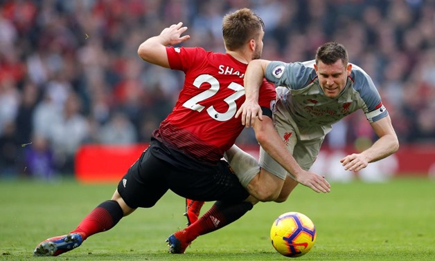 Soccer Football - Premier League - Manchester United v Liverpool - Old Trafford, Manchester, Britain - February 24, 2019 Liverpool's James Milner in action with Manchester United's Luke Shaw REUTERS/Phil Noble