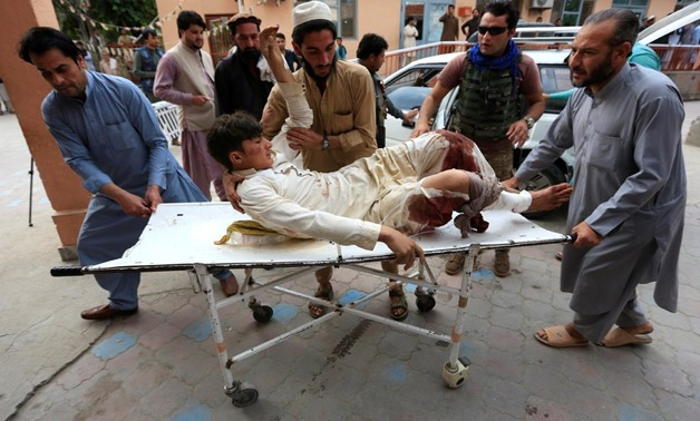 A wounded man after a bomb blast at a mosque in in Nangarhar Province, Afghanistan, on Friday.CreditCreditParwiz/Reuters