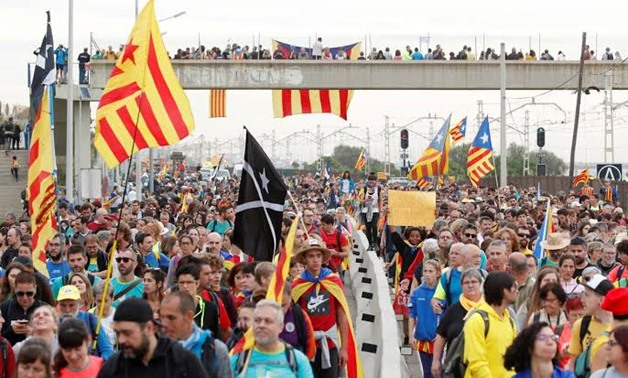 Hundreds of protesters faced off against police in the heart of Barcelona on Friday