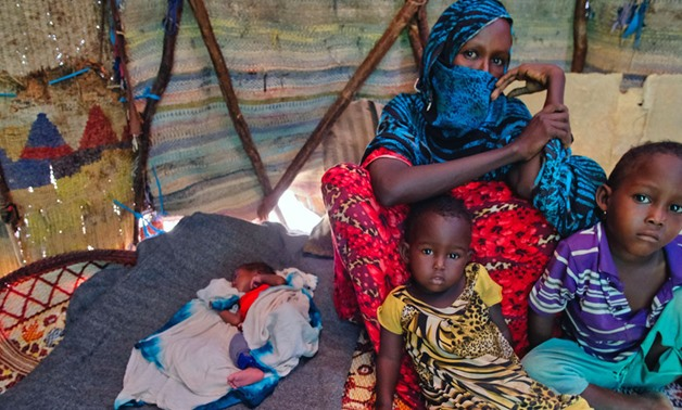 Farhia Mousa sits with three of her six children, including Nacima, 10-days-old, Abdulahi, 4-years-old, and Nasterha, 2-years-old, in a camp for people displaced by conflict and drought in Dangaroyo, Somalia. (22 May 2019) - UNICEF