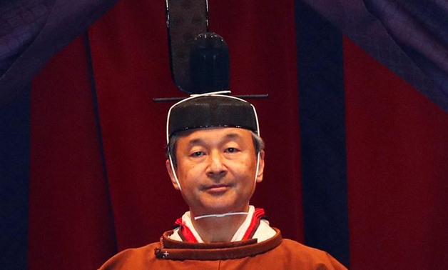 Japan's Emperor Naruhito leaves a ceremony to proclaim his enthronement to the world, called Sokuirei-Seiden-no-gi, at the Imperial Palace in Tokyo, Japan, October 22, 2019 in this photo released by Cabinet Office of Japan. Cabinet Office of Japan/Handout