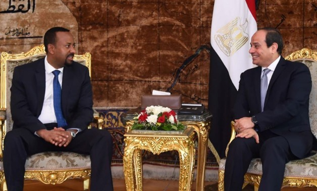FILE - Egyptian President Abdel Fattah al-Sisi (R) meets with Ethiopian Prime Minister Abiy Ahmed (L) at the Ittihadiya presidential palace in Cairo, Egypt, June 10, 2018 – Reuters
