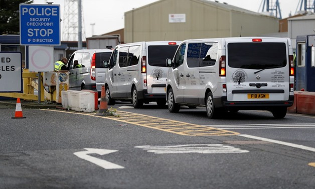 Vehicles of a funeral home arrive at the Port of Tilbury where the bodies of immigrants are being held by authorities, following their discovery in a lorry in Essex on Wednesday morning, in Tilbury, Essex, Britain October 25, 2019. REUTERS/Peter Nicholls