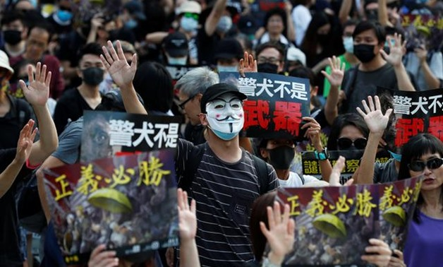 An anti-government demonstrator wearing a Anonymous mask attends a protest in Hong Kong's tourism district of Tsim Sha Tsui, China October 27, 2019. REUTERS/Kim Kyung-Hoon