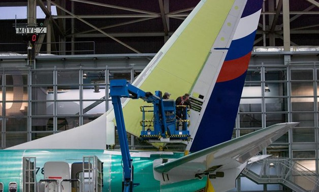 FILE PHOTO: Boeing employees work on the tail of a Boeing 737 NG at the Boeing plant in Renton, Washington December 7, 2015. REUTERS/Matt Mills McKnight