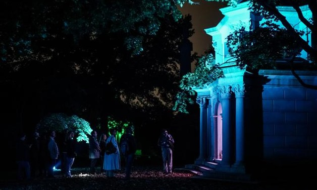 Tourists look at the Webb family mausoleum during the Moonlight Mausoleum tour at Woodlawn Cemetery in Bronx in New York City, New York, U.S., October 25, 2019. REUTERS/Jeenah Moon